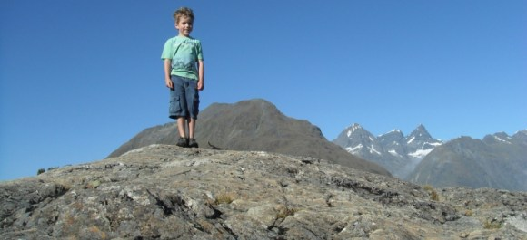 Liam standing on a rocky hill on the Routeburn Track.