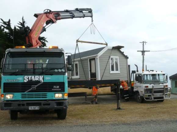 The cabin is place at the new Godley Head site by crane.