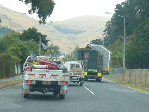 Scott's cabin makes its way from Sumner to Godley Head by road.