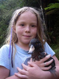 Girl holding whio.