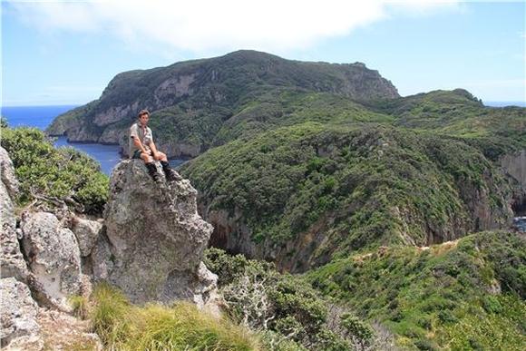 Ranger Guy in sitting on a rock on Hen Island.