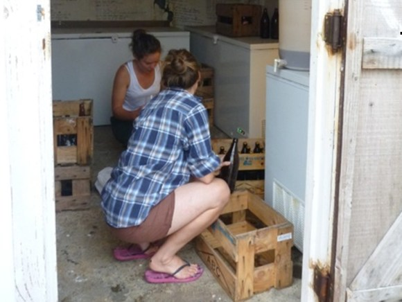 Volunteers check on the beer in the storehouse.