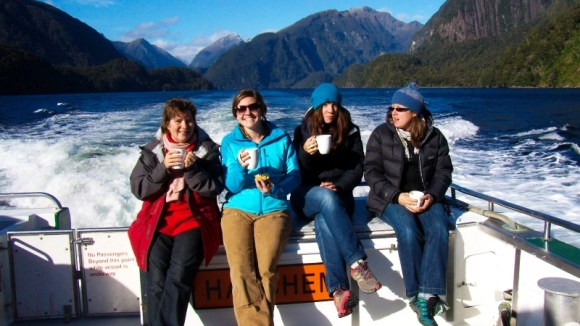Some of the Visitor Information team having a coffee on the boat.