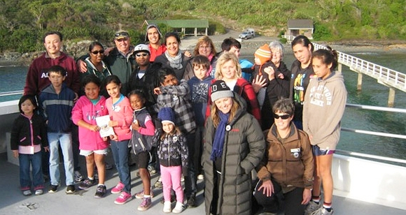 Lucy Lawless on the ferry with some of the 'Kiwi Ranger' families.