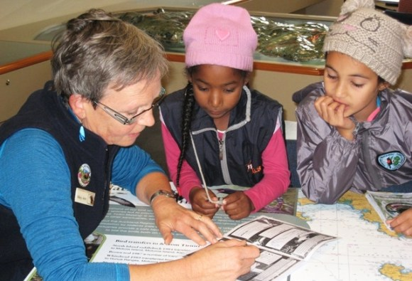The children share their completed activities with the Supporters of Tiritiri Matangi.