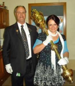 Gina holding mace.