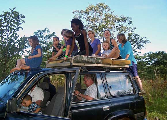 "Grab a seat and hang on for dear life. Our family trips ""bundu (bush) bashing"" in Lusaka Zambia are legendary. I'm the one lurching off the back, my sisters atop."