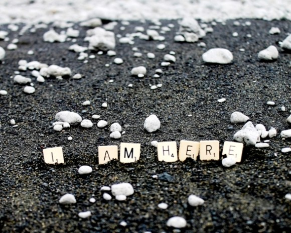"Scrabble letters on the Raoul Island beach saying ""I am here"". Photo Sarah Matthew."