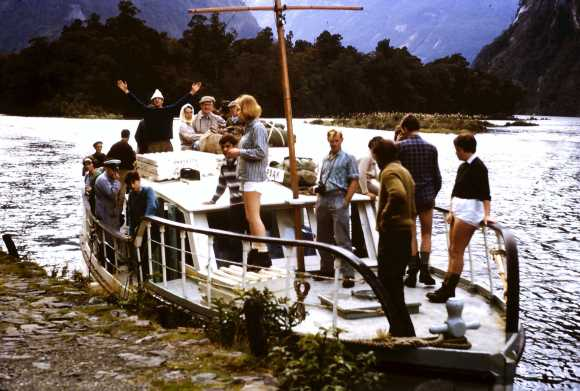 A boat with Otago Tramping Club members arriving at Sandfly Point.