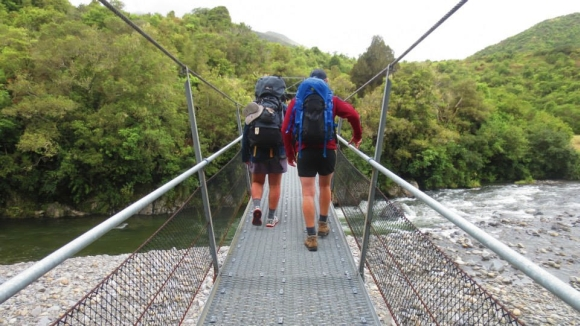 Crossing a bridge on the Tararua Southern Crossing.