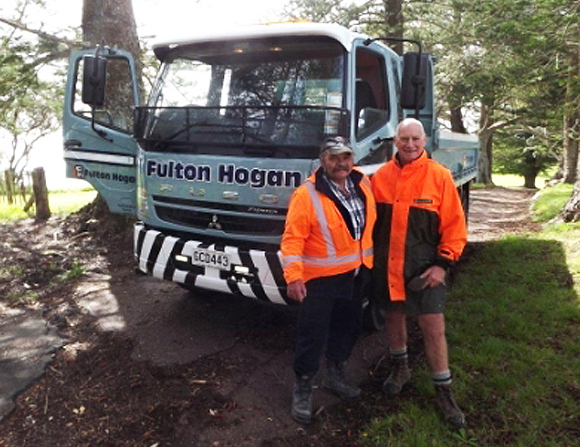 Paul Hart (left) from Fulton Hogan and DOC's Motuihe  Ranger John Mills, on the road before repairs were  carried out.