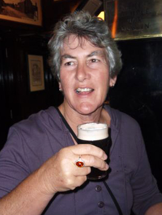 Alison with a glass of Guinness at Temple Bar in Dublin.