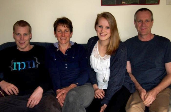 Photo of the Holzpfel family on the couch.