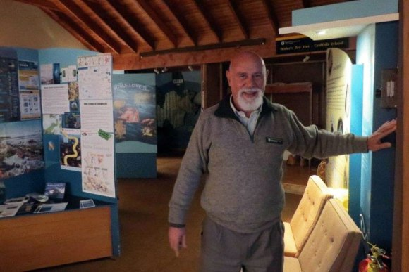 Ranger Gary Cocker turning out the lights at the end of the day in the Rakiura National Park Visitor Centre.