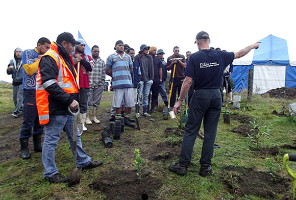 OPAC staff get planting instruction from Bay of Plenty Regional Council Land Management Officer Tim Senior.