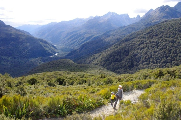 Caroline walking with her son in Fiordland National Park.