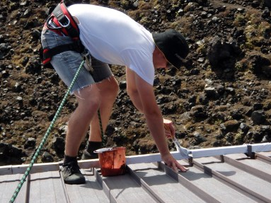 Preparing Tararua Hut roof for painting