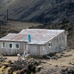 Preparing Tararua Hut roof for painting.