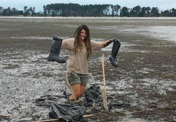 Emma wading in the mud at at Heathcote Estuary.