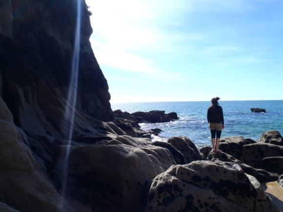 Emma on the shore at Totaranui.