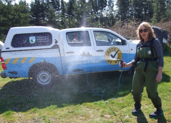 Ranger checks, cleans and dries her vehicle after a day in the field.