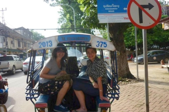 Alice and a friend on a tuk tuk in Cambodia.