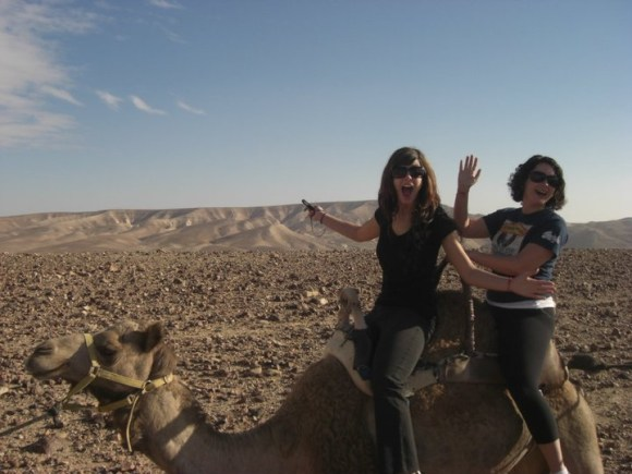 My sister and I riding a camel in Israel.