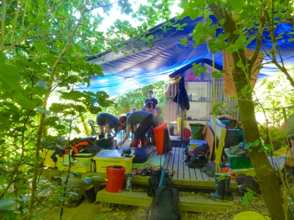 Organising under the tarpaulin at the tiny DOC hut.