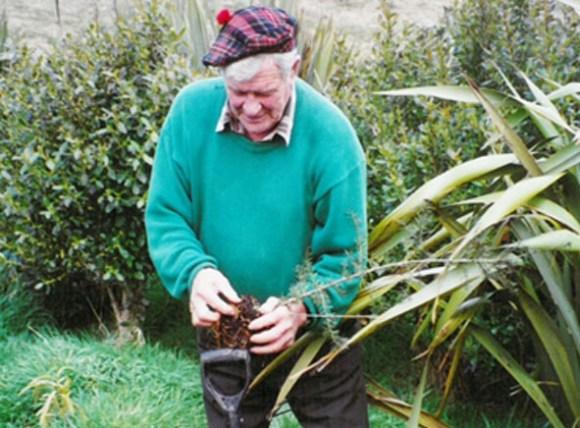 Arthur planting native trees.