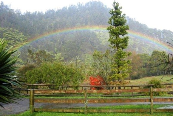 A small rainbow viewed from the front deck of Greg's house.