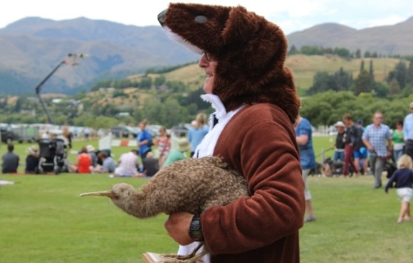 DOC Partnerships Ranger Greg Lind with a stuffed Kiwi.