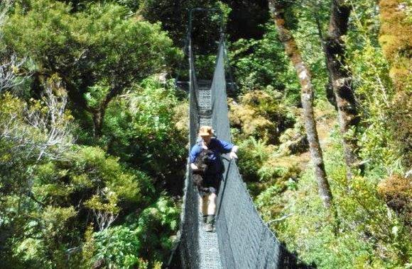 Andrew Mercer crossing a swing bridge.