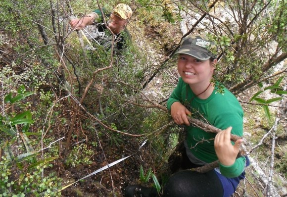 Jess Scrimgeour ecology technical advisor and Dave Conley partnership ranger setting up the first plot on a steep hillside.