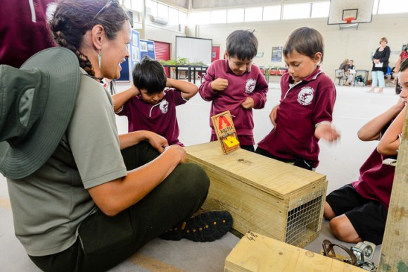 DOC ranger helps with basecamp activities at Tolaga Bay Area School Gym. Uawanui Sustainability Project Bio Blitz. Tolaga Bay. Photo: Mark Coote ©