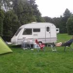 A spacious campsite and cricket pitch at Holdsworth Conservation Campsite.
