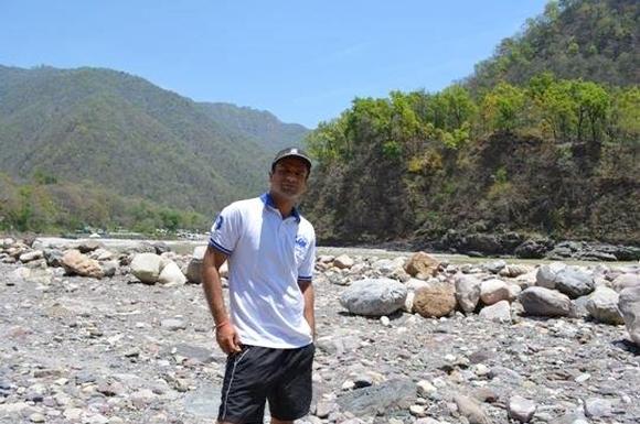 Abhishek camping in the Himalayas.