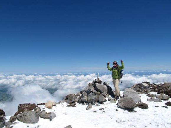 Ann on the summit of Mount Taranaki.