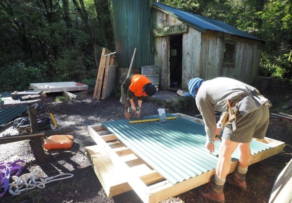 DOC rangers building the wood shed at Cone Hut.