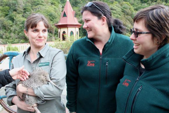 Threatened Species Ambassador Nicola Toki holding Flip Flop the little spotted kiwi.