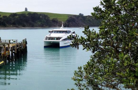 Boat approaching Rangitoto Island.