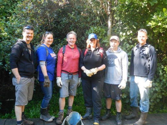 A group of weeding volunteers at Colonial Knob.