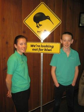 Siena and Liam with a kiwi road sign.