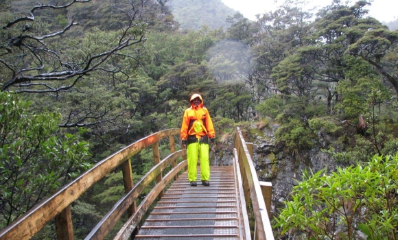 Raj on the arched-wooden bridge on the Rangiwahia Hut Track. Photo: DOC.