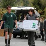 Nicola Toki and Heath Sinclair transporting rowi kiwi.