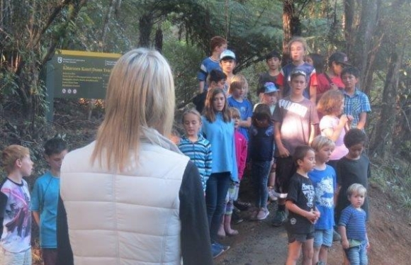 Children welcome Minister Kaye with waiata/songs.