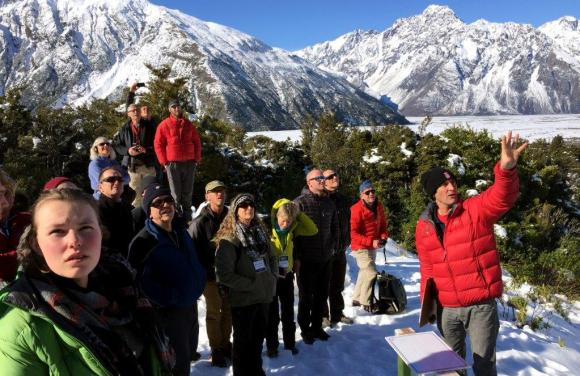 Dr Simon Cox (in red) presents at Sustainable Summits, Aoraki/Mt Cook.