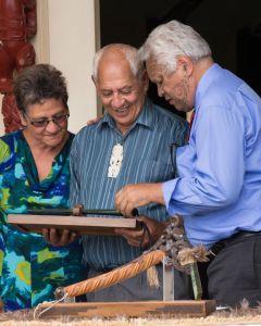 Kuia Charmaine Butler, Kaumātua Bevan Taylor, and Te Putahitanga Joe Harawira with the mere pounamu gifted from DOC to Maungaharuru-Tangitū. Photo: Lauren Buchholz
