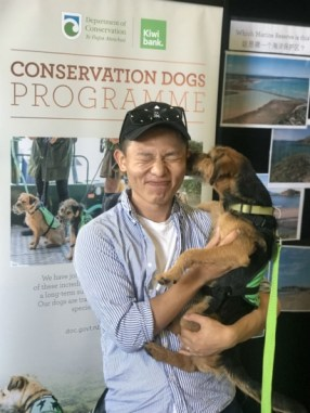 Taking a photo with Pipi, the conservation dog. Photo: Tony Sun.