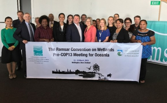 Ramsar Convention delegates and Conservation Minister Eugenie Sage.