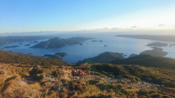 Volunteer Becky and ranger Lyndsay on the evening descent to Dusky Sound.